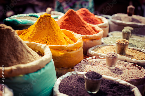 Poster India Indian colored spices at local market.