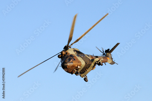 Tuinposter Helicopter A antitank helicopter on sky
