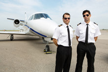 Pilots Standing In Front Of Pr...