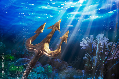 Photo  Trident on a dramatic underwater background