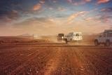 Cars in the desert at sunset - 60027681