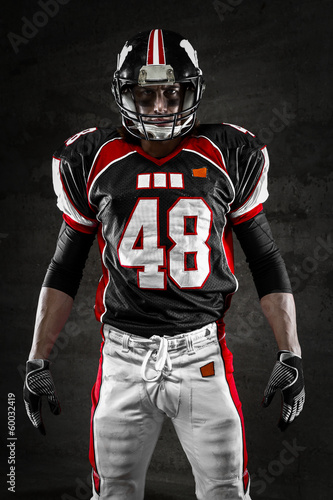 Valokuva  Portrait of american football player looking at camera