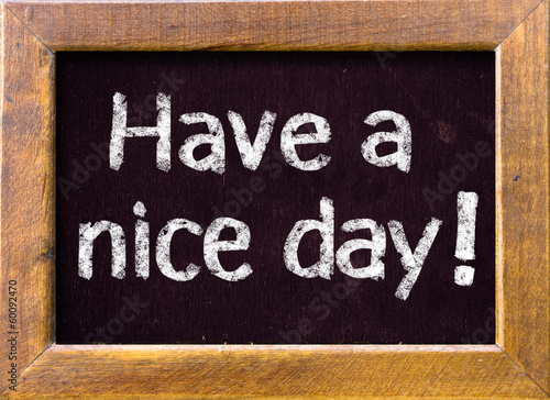 Photo  Have a nice day ! written on blackboard
