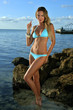 Sexy bikini model posing early in the morning at the ocean
