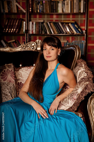 Türaufkleber Gondeln Beautiful woman in a long blue dress in the rich interior. Young
