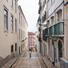 Typical narrow street in Lisbon, Portugal.
