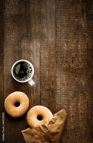 Fotografie, Tablou Sugared doughnuts and coffee on rustic wood