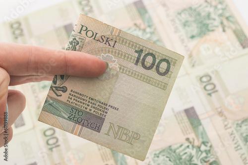 Fototapeta Łapówka - nacjonalizacja - ręka na pieniądzach obraz