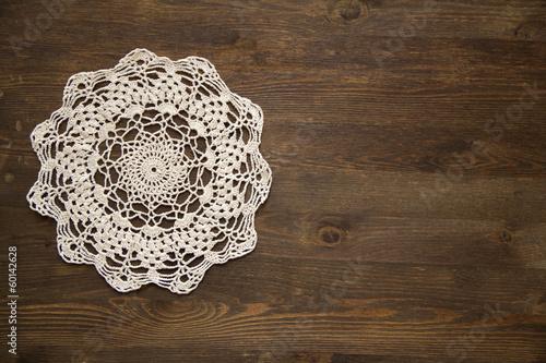 Valokuva Crochet doily overdark  wood