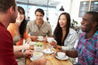 canvas print picture - Group Of Friends Meeting In Coffee Shop