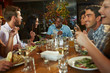 canvas print picture - Group Of Friends Enjoying Meal In Restaurant