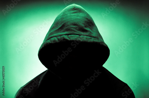 Valokuva  Man wearing hood with face in shadow