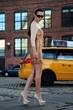 Fashion model posing at historical area under Manhattan bridge