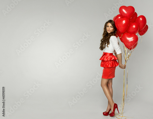 Photo  Attractive young woman with balloon on Valentine Day