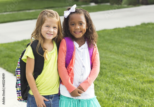 Cute Little girls walking to school together Poster