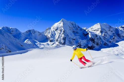 Staande foto Nepal Skiing, skier, winter sport - woman skiing downhill