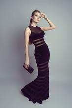 Elegant Blonde In Luxury Black Dress Holding A Handbag