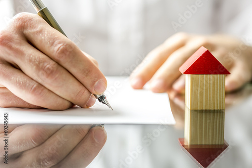 Fototapeta Man signing a contract when buying a new house obraz