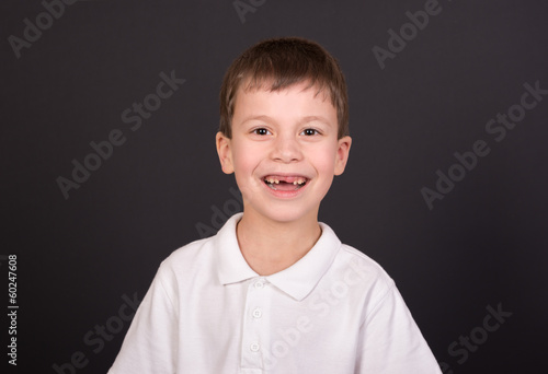 Fototapety, obrazy: boy portrait in white shirt on black