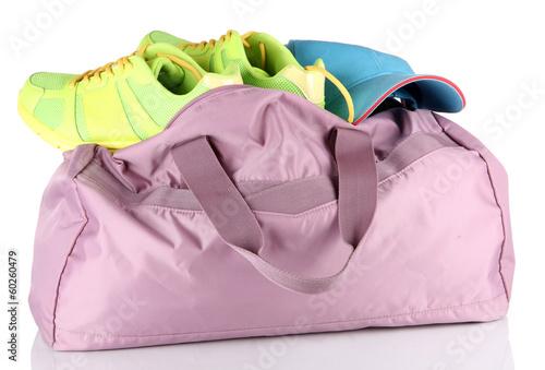 Fototapeta Sports bag with sports equipment isolated on white obraz na płótnie