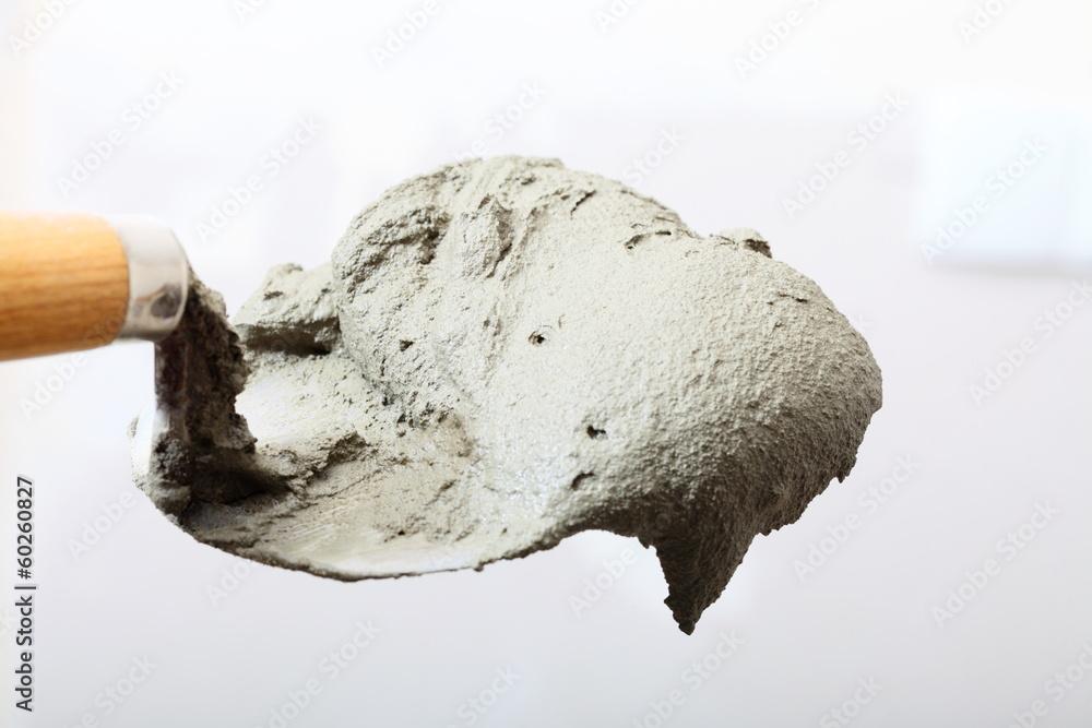 Fototapeta Close up bucket trowel with cement mortar