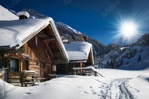 winter ski chalet and cabin in snow mountain  landscape in tyrol Fototapete