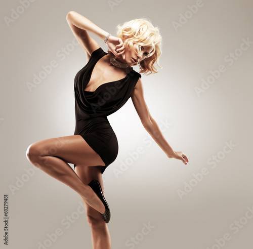 Beautiful female dancer  in black dress плакат