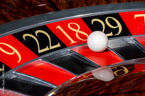 Fotografia  Classic casino roulette wheel with red sector eighteen 18