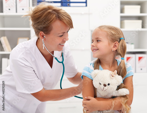 Fotografia  Little girl at the doctor for a checkup examination