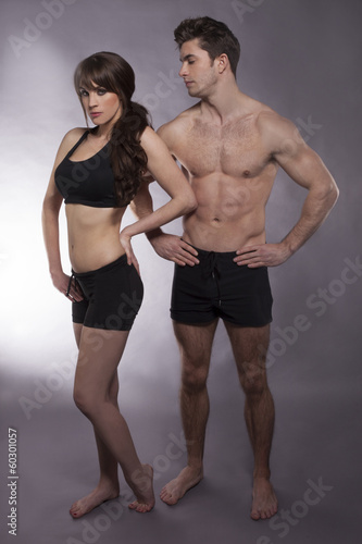 Spoed Foto op Canvas Fitness Young couple exercise together