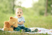 Little Boy Playing With A Tedd...
