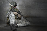 Fototapeta Teenage - Soldier with rifle and mask resting
