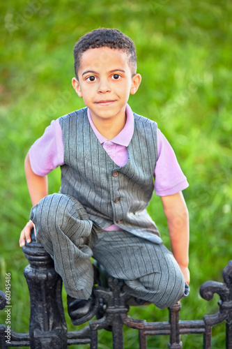 Fotografie, Obraz  Little boy dressed in suit with vest sits