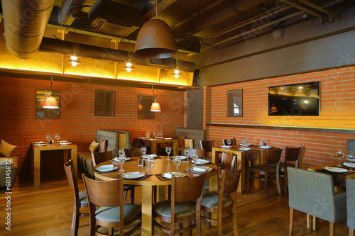 Fotobehang Restaurant Restaurant hall with wooden round table in the center
