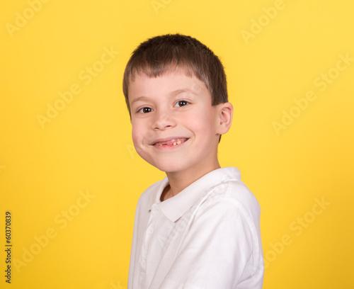 Fototapety, obrazy: boy portrait in white shirt on yellow