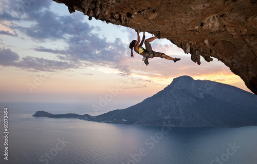 Leinwand Poster Young female rock climber at sunset, Kalymnos Island, Greece