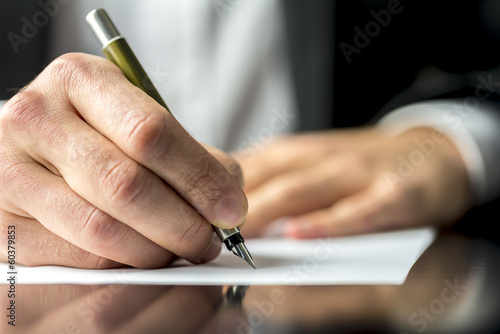 Fotografía  Businessman signing or writing a document