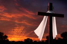 Dramatic Lighting On Christian Easter Cross At Sunrise