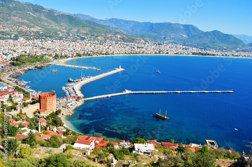 Photo View of Alanya harbor from Alanya peninsula. Turkish Riviera