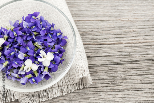 Edible violets in bowl