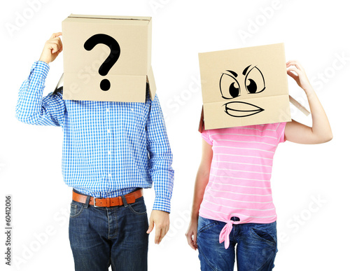 Fotografía  Couple with cardboard boxes on their heads isolated on white