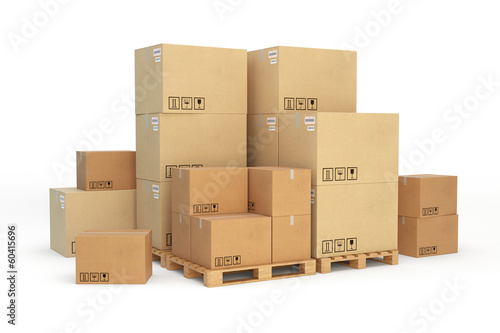 Fotografía  Cardboard boxes on a pallet. Isolated on white background.