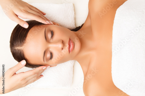 Fotografie, Obraz  Face Massage. Close-up of a Young Woman Getting Spa Treatment.