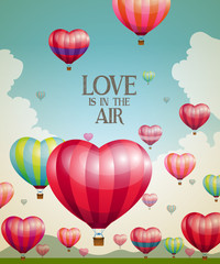 Fototapeta Romantyczny Heart-shaped hot air balloons taking off with a vintage effect
