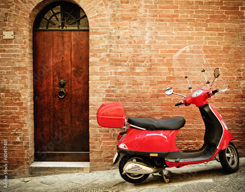 Vintage image of red scooter on the street Wallpaper Mural