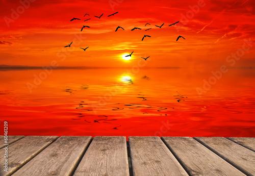 Foto op Canvas Rood el oceano se tiiñe de rojo al amanecer