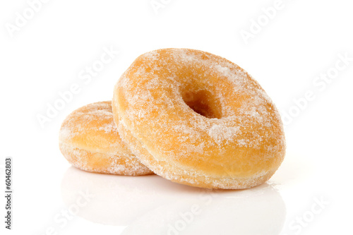 Photo  Two stacked sugared donuts over white background
