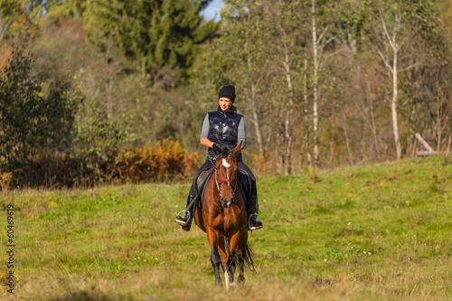 Acrylic Prints Horseback riding Elegant attractive woman riding a horse