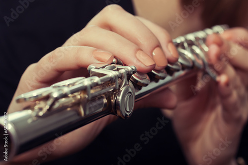 Fotografie, Obraz  Hands girl playing a flute
