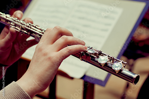 Fotografie, Obraz  Hands of a woman playing a flute